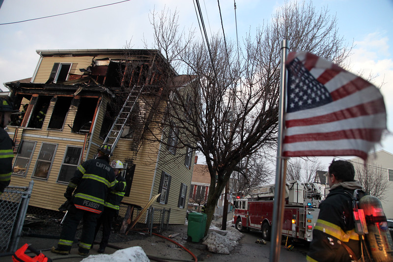 Firefighters tend to 28 Harris Street in Peabody Tuesday January 26, 2010. Item Photo/ Reba M. Saldanha