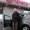 Chuck Kelly of Saugus poses with his new Toyota Prius from Atlantic Toyota on the Lynnway Wednesday January 27, 2010. Item Photo/ Reba M. Saldanha