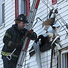 A Lynn fire fighter searches for flames at 1 Den Quarry Road in Lynn