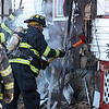 Lynn fire fighters battle what is left of the fire at 1 Den Quarry Road in Lynn.