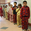 Each of these first graders at the Sewall Anderson School donated two dollars or more for the privilege of wearing their pajamas to school. The money is going to help the victims in Haiti. The school raised one thousand dollars.