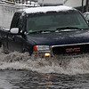 Saturday Jan2. Extremely high tides cause street flooding like this at the Belden Bly Bridge coming into Lynn at noon.