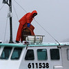 Saturday Jan. 2. A fisherman secures his boat at Philip Clark Landing in Marblehead. Tides were extremely high.