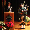 Bag piper Ned Shinnick joins City Council President Tim Phelan on stage during the Cityof Lynn Inaugural Exercises January 4, 2010 at Lynn Veterans Memorial Auditorium at City Hall. Item Photo/ Reba M. Saldanha