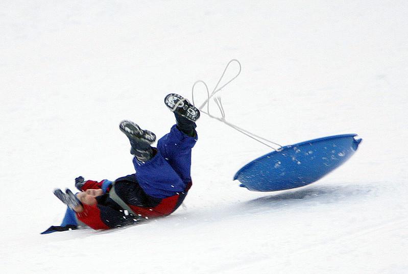Brady Bethell sleds down a hill at Gannon Golf Course in Lynn Tuesday January 5, 2010. Item Photo/ Reba M. Saldanha