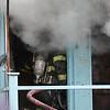 Lynn fire fighter in the front door of 29 Oakwood Ave.