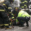 A Lynn fire fighter collapses.