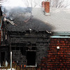 The charred remains of the house at 29 Oakwood Ave, in Lynn, the scene of a multi alarm fire this morning.