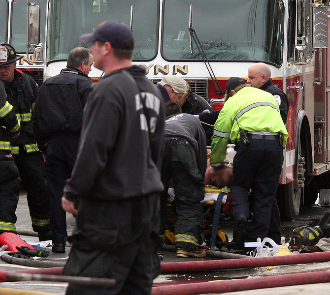 Lynn fire fighter being taken to the hospital