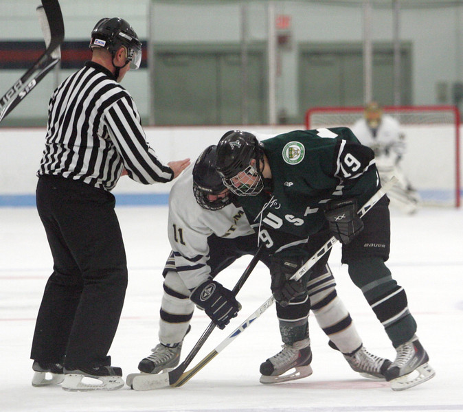 St. Mary's Bryan Wright and Austin Prep's Casey Miller at Connery Rink in Lynn Wednesday January 6, 2010. Item Photo/ Reba M. Saldanha