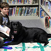 Second graer Daniel Lowry reads to Ms. Merry, a certified reading and education assistance dog, and her trainer Donna Carmody of Swampscott (not pictured), who donated her time to the library Wednesday afternoon January 6, 2010. Item Photo/ Reba M. Saldanha