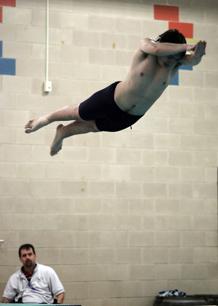 Lynn Tech diver Josh Mcconaghy competes  against Minute Man Tech in Lynn Wednesday January 6, 2010. Item Photo/ Reba M. Saldanha