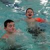 Twins Brendan and Zachary McKenna, 8, make a splash during the Lynn Parks and Rec open swim at Lynn Tech Sunday January 31, 2010. Item Photo/ Reba M. Saldanha