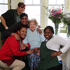 Kay Hart, 100 years old, and the staff that takes care of her at the Bertram House in Swampscott.