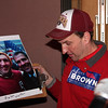 Larry Carlson with his autographed picture of Scott Brown