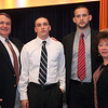Coach Peter Holey with MVP Sam Hill, his brother STephen Hill, and his mother Sue during the Lynn English High School footbal banquet Sunday January 31,2010. Item Photo/ Reba M. Saldanha