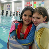 Friends Alexandria Jernandez, right, and Jessinia Molinari both 8, pose for a photo after swimming during the Lynn Parks and Rec open swim at Lynn Tech Sunday January 31, 2010. Item Photo/ Reba M. Saldanha
