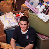 Breed Middle School student Tyler Culp poses with the medical supplies he collected for earthquake victims in Haiti in his Lynn home Wednesday February 3, 2010. Item Photo/ Reba M. Saldanha