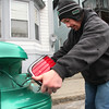 Lawrence Nagel of Rockaway Street in Lynn prepares for the snow storm by changing the bulbs in his tail lights.