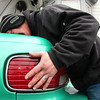 Lawrence Nagel of Rockaway Street in Lynn prepares for the snow storm by changing the tail lights in his car.
