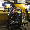 Ron MacDonald puts the finishing touches on plows at the DPW garage in Lynn today.
