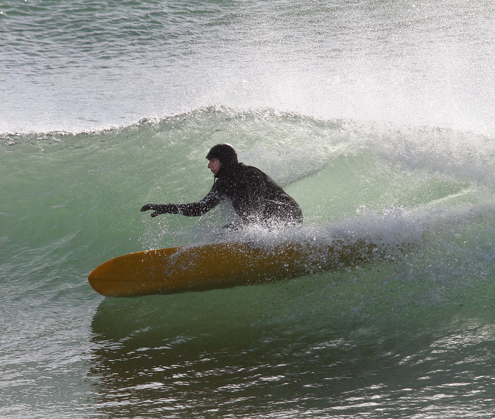Ed Tekeian surfed off of Lynn Beach for an hour this morning before going to work.