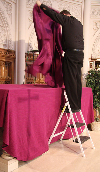 Father Joe Rossi prepares the altar at St. Pius Church in Lynn for Ash Wednesday.