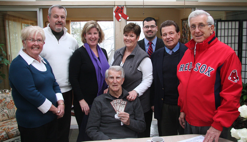 Haiti relief raffle on Opening Day. Left to right: Joan McGovern Regan, Phil Ouellette, General Manager of the Lynn Item, Lucy Dearborn, Lucia Lighting and Design, Joanne Deveau, Johnny Pesky's niece, Joel Soliminie, Soliminie Funheral Home, Dave Hughes, Century 21 Real Estate, Dave Soliminie Sr. Soliminie Funeral Home and Johnny Pesky, seated with Red Sox tickets.