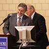 North Shore Community College President Wayne Burton turns the podium over to Congressman John Tierney this morning so he could begin his talk on college loan programs.