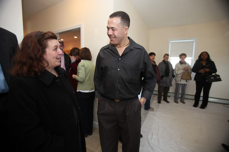 Mayor Judith Flangan-Kennedy chats wtih home owner Francisco Morel in his new Habitat for Humanity home on Camden St in Lynn on Sunday February 21, 2010. Item Photo/ Reba M. Saldanha