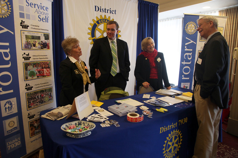 Rotary International district Governor Ingrid Brown, left, and colleagues Matthew Schroeder and Claudia Frost talk about Rotary service with Mike Sobus, right, of Peabody during the North shore business expo Tuesday February 23, 2010. Item Photo/ Reba M. Saldanha