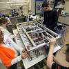 Members of the Lynn Tech robotics team (from left) Rallanny diaz, Amanda Pearson, Daniel Hegarty, and volunteer advisor Paul Woodley prepares this year's entry for shipping to the competition on Tuesday February 23, 2010. Item Photo/ Reba M. Saldanha