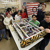The Lynn Tech robotics team prepares this year's entry for shipping to the competition on Tuesday February 23, 2010. Item Photo/ Reba M. Saldanha