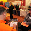 Lisa brown of the North Shore Career Center in Lynn gets her caricature drawn by Bill Gage of Fun Enterprises Inc during the North Shore Business Expo in Danvers Tuesday February 23, 2010. Item Photo/ Reba M. Saldanha