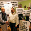Home owners Cristino Acosta, right, and Alex Griswold pose with supporters in Acosta's Collins St home Tuesday February 23, 2010. Item photo/ Reba M. Saldanha