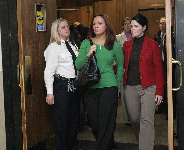 Fiance Connie Bethell, center in green, leaves the courtroom after the conviction of Robert Iacoviello and James Heang in the murder of Revere police officer Daniel Talbot at Sufflok Superior Court Tuesday February 2, 2010. Item Photo/ Reba M. Saldanha