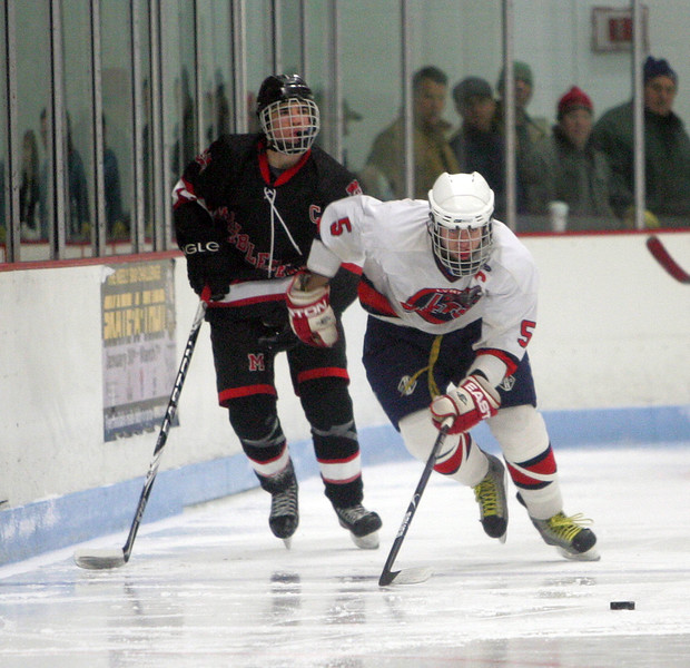 Lynn Jets Jeff Porter and Marblehead's Jake Kulevich at Connery Rink Wednesday February 3, 2010. Reba M. Saldanha