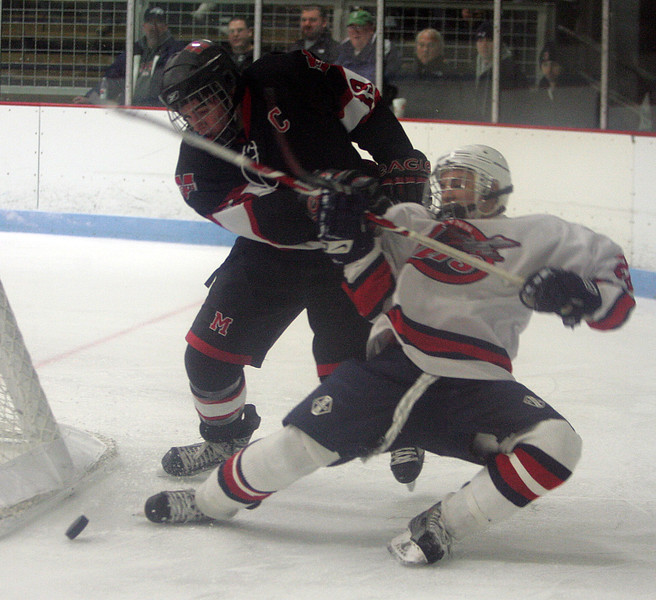 Lynn Jets Bucky Surette and Marblehead's Jake Kulevich at Connery Rink Wednesday February 3, 2010. Reba M. Saldanha