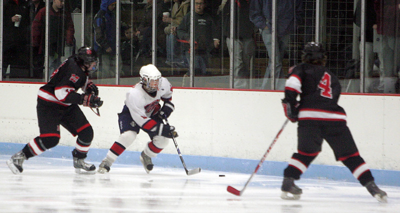 Lynn Jets Kyle Martin and Marblehead's Alex Whitmore and Anders Gundersen, right, at Connery Rink Wednesday February 3, 2010. Reba M. Saldanha