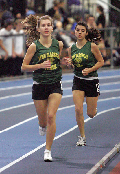 Classical's Saska Iotavic, left, and Stella Athanasop compete at the NEC track meet at the Reggie Lewis Center in Roxbury Thursday February 4, 2010. Item Photo/ Reba M. Saldanha