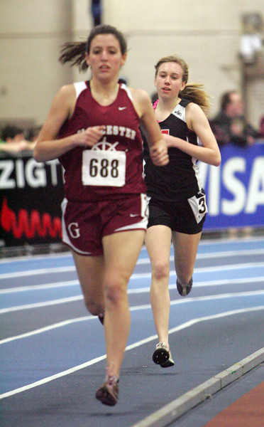 Gloucester's AbbieRogers and Marblhead's Madeline Piela compete at the NEC track meet at the Reggie Lewis Center in Roxbury Thursday February 4, 2010. Item Photo/ Reba M. Saldanha