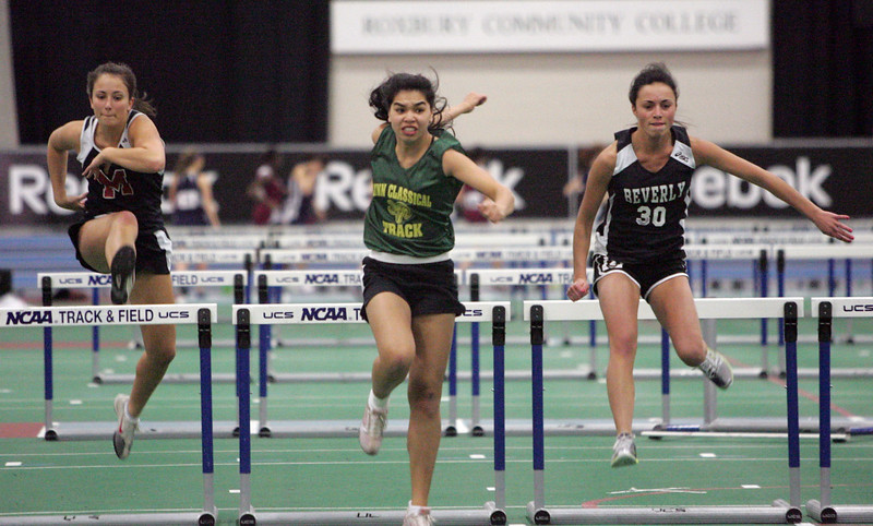 (from left) Morgan Butler of Marblehead, Katie Thongchanh of Lynn Classical, and Taylor Manzi of Beverly compete at the NEC track meet at the Reggie Lewis Center in Roxbury Thursday February 4, 2010. Item Photo/ Reba M. Saldanha
