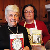 Mother and daughter cooking duo Doris Spacer and Leslie Breen pose with their books in Spacer's Peabody home Thursday February 4, 2010. Item Photo/ Reba M. Saldanha