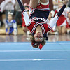 captain Jenna Carrabino of Revere competing with her team at the Northeastern Conference Cheerleading competition held at English High on Saturday.