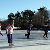 (from left) Mary Collins, Molly Mannion, Ciara Collins, and Cormac Collins skate on a frozen Flax Pond in Lynn Sunday February 7, 2010. Item Photo/ Reba M. Saldanha