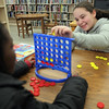 Jada Davis, right,a nd Nana Phillips play a game of Connect Four at Lynn Public Library Monday February 8,2010. Item Photo/ Reba M. Saldanah