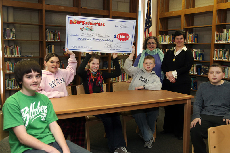 Belmonte Middle School seventh graders (seated from left) Ryan Virgin, Jiana Capone, Emma Turgeon, David Baumann, and Jonathan Capone jkoin vice principal Myra Monto, standing on right, and librarian Sharon Hamer with a check for $1500 from Bob's Discount Furniture in the school's library Monday February 8, 2010. Item Photo/ Reba M. Saldanha