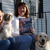 The Witches That Saved the Dogs co-authors Lily Ditchfield, left, and Julie Zielski pose with Shih Tzu Emma and Labrador Katie in their Peabody neighborhood Tuesday March 9, 2010. Item Photo/ Reba M. Saldanha