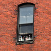 Bottle in a window on Monroe Street in Lynn.