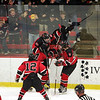 Marblehead's Jake Kulevich is hoisted by teammate Anders Gundersen after his first period goal against Scituate during the Eastern Mass Division 3 final at Harvard's Bright aRena Wednesday March 10, 2010. Item Photo/ Reba M. Saldanha